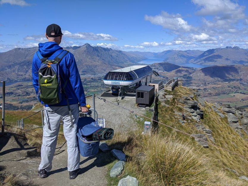 holding picnic basket at coronet peak near queenstown