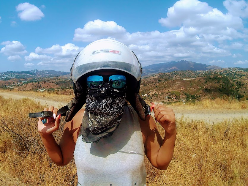 a lady with a full head gear ready for a quad ride