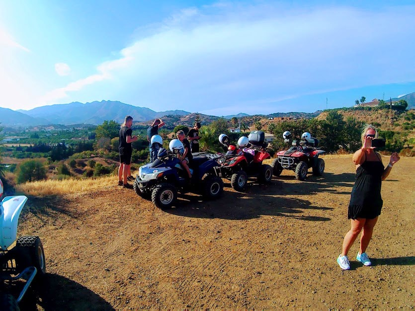 A team of quad riders stopped for a brake and pictures taking