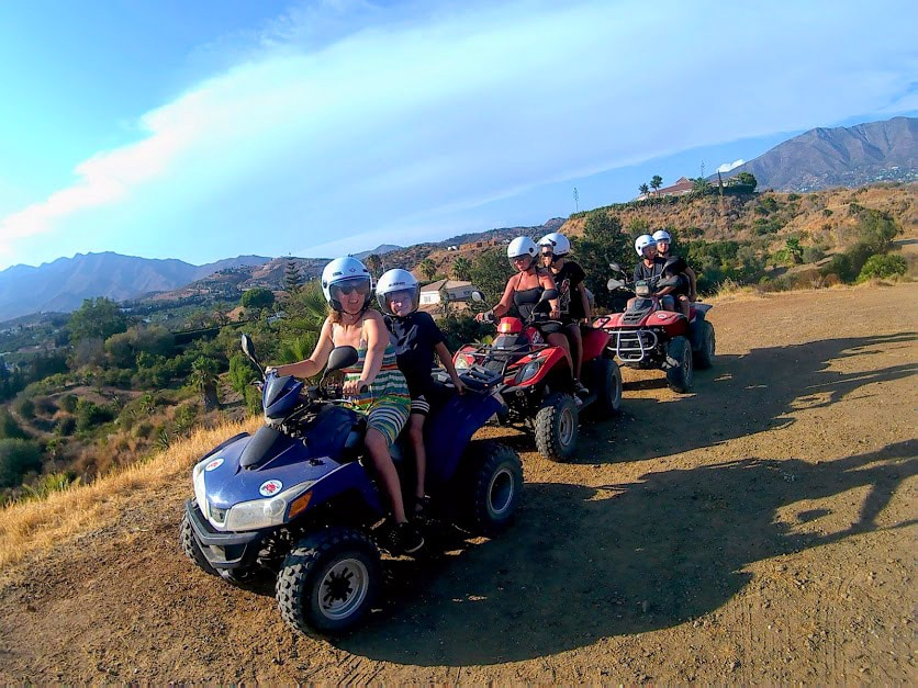 3 quads stopped on a hill for a break
