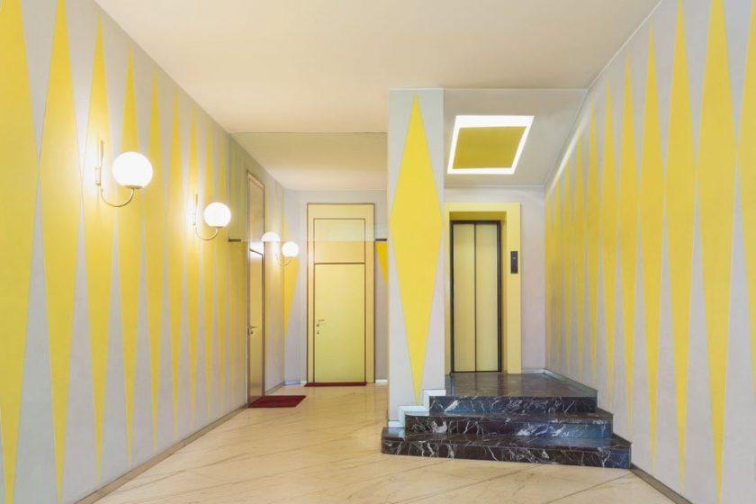 Casa Melandri, Gio Ponti, Alberto Rosselli, 1954–57 Sconces by Candle. floor: Carrara marble stairs: Rosso Levanto ophicalcite Copyright: © Delfino Sisto Legnani