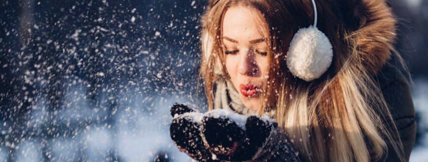 Girl Blowing snow in the wind