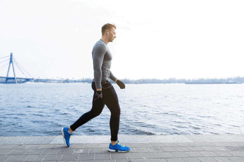 A guy has a cardio exercise by walking.