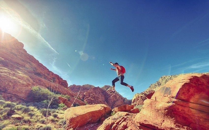 Man jumping over rocks