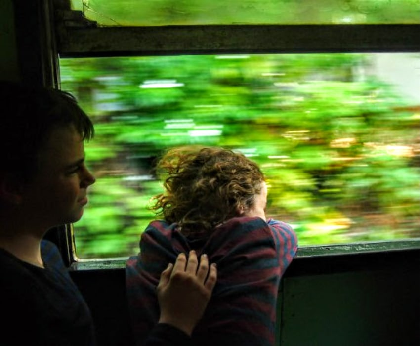 kids enjoying train ride Train from Colombo to Galle Sri Lanka