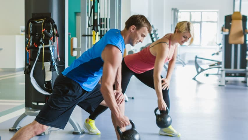 woman and man in gym