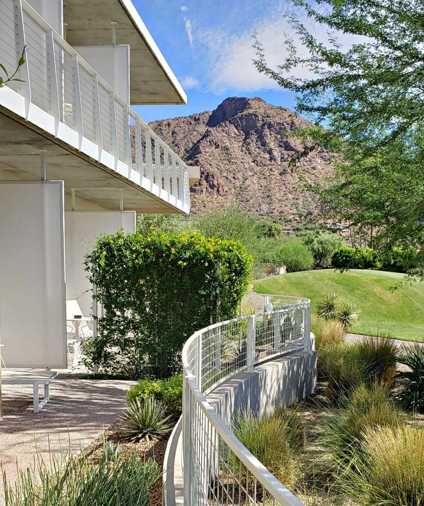 Balconies with mid-century modern architecture, minimalist white metal fence around garden/patio area and Camelback Mountain from my patio