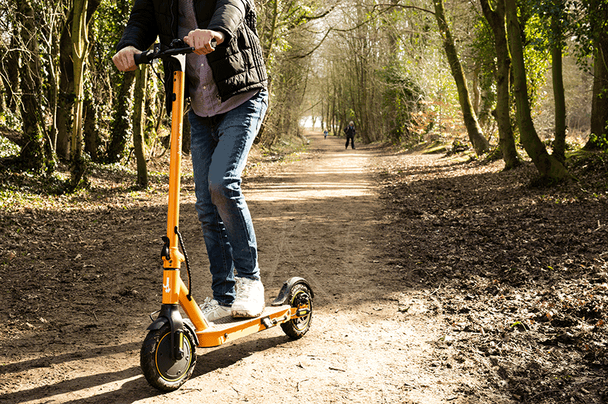 Teenager riding electric scooter on private land