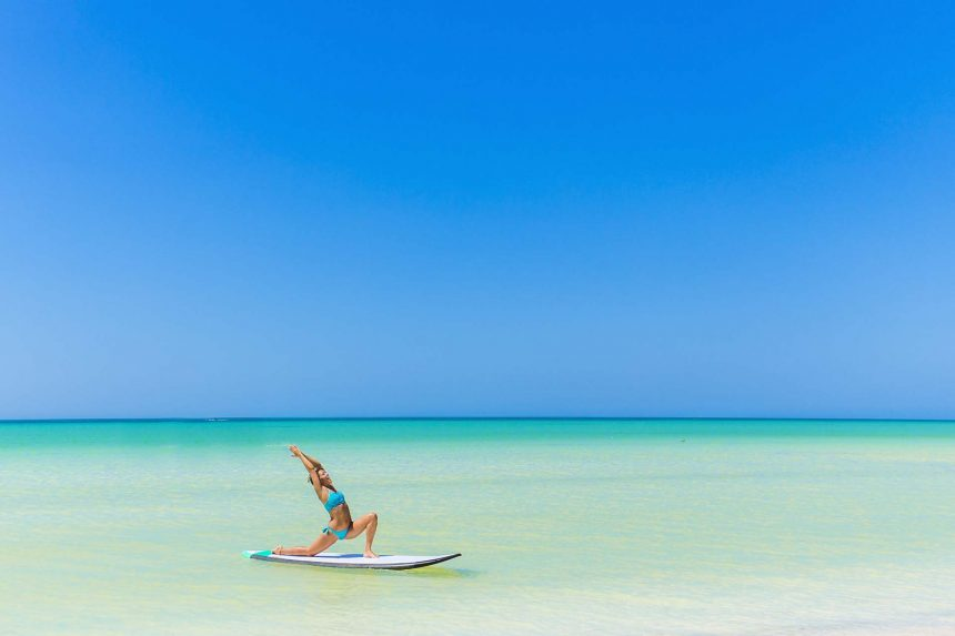 Yoga Training on a Paddleboard at the beach in Holbox