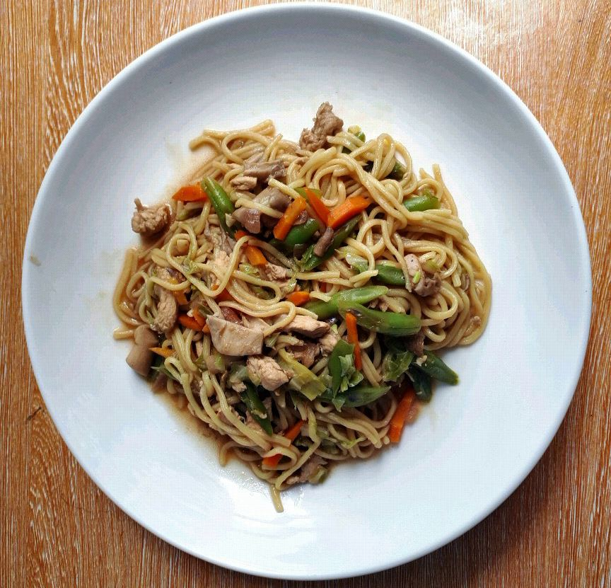 A filipino version of egg noodle mixed with chicken, mushroom, and vegetables called Pancit Canton