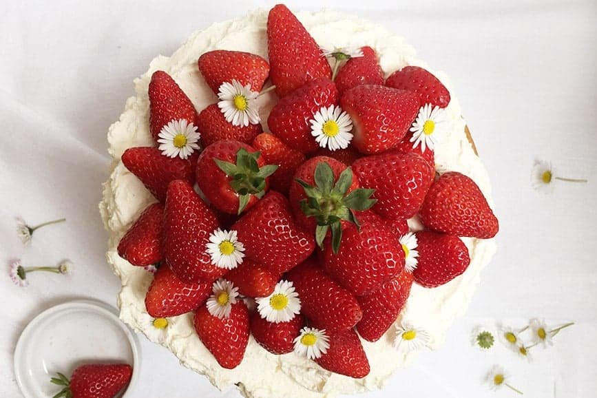 A Cake with Strawberries at the top