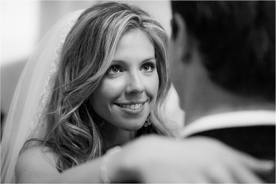 Beautiful black-and-white detail photo of a bride smiling at her new husband