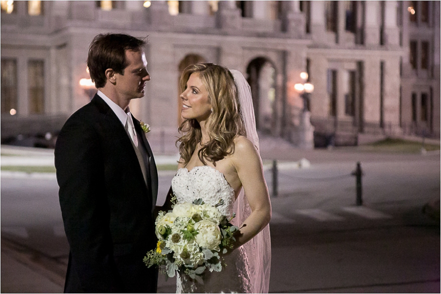 Another beautiful wedding day portrait of a bride and groom standing outside of the Texas State Capitol building