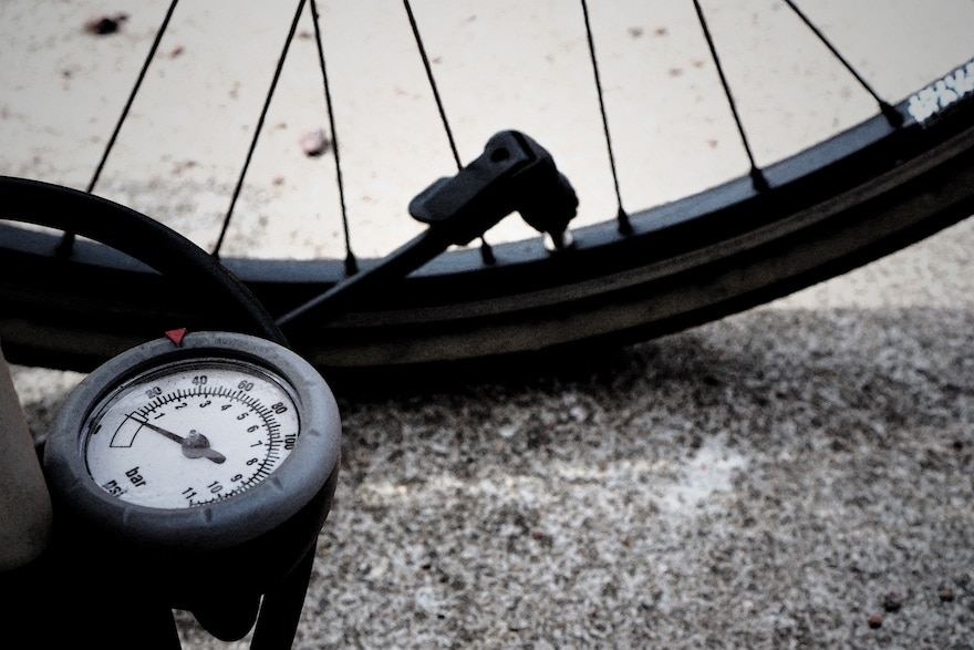 Closeup of a bike pump in place on a valve