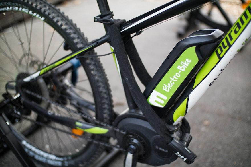 Closeup of an e-bike battery on the frame of a bike