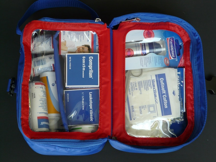 A first aid kit opened on a counter