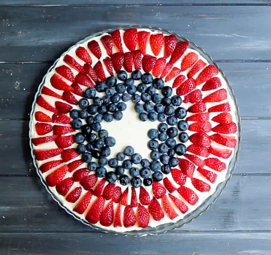 """Red, White and Blue Cheesecake Dip. A no bake, super easy and impressive dessert for the fourth of July or any time you want to be a dessert """"hero."""""""