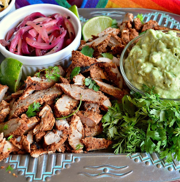 Mexican grilled pork, avocado cream, pickled onions