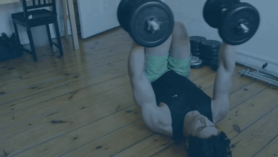 a guy weight lifting in his dining room