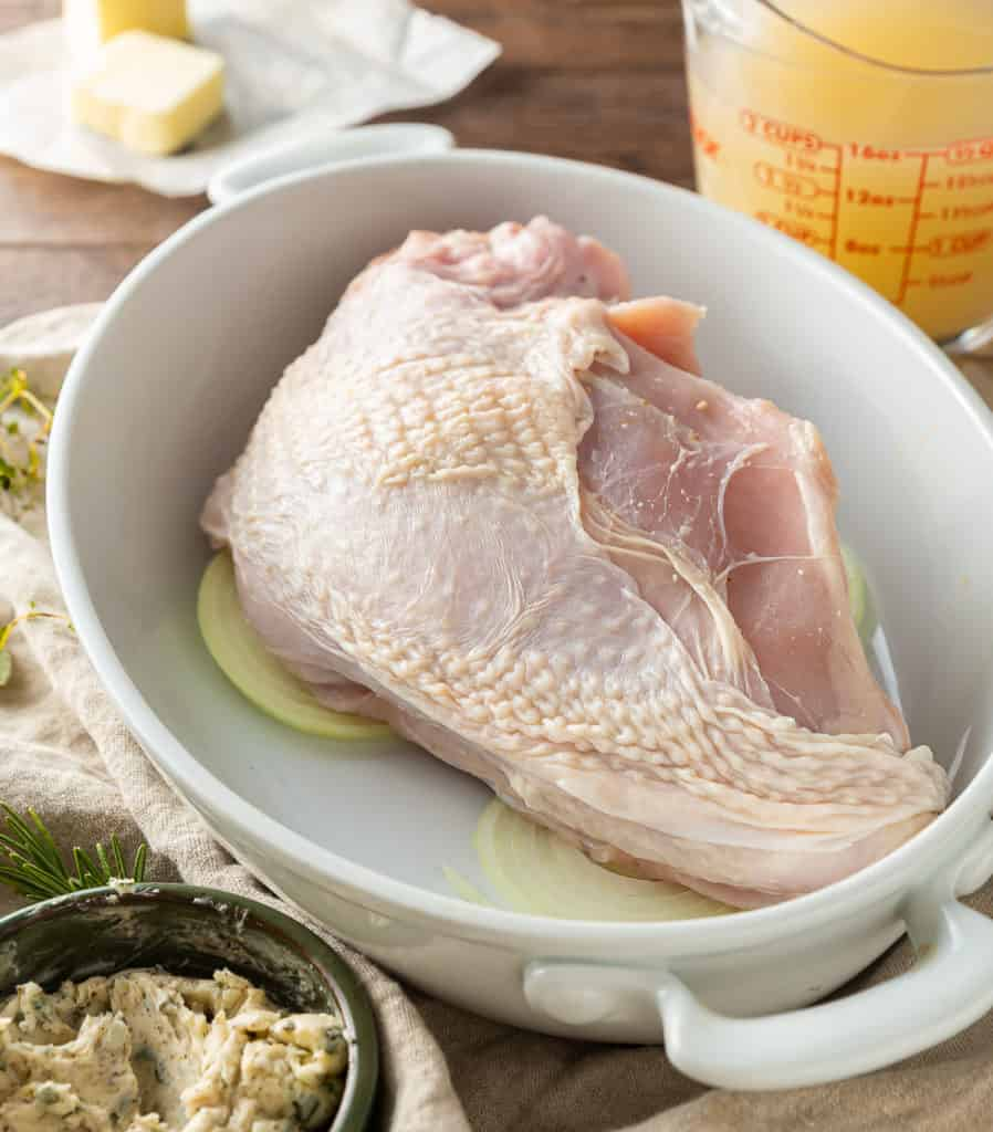 Bone in Turkey Breast ready for roasting on onions