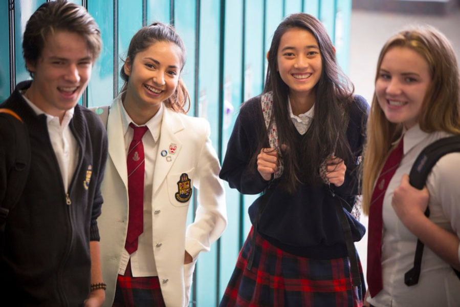 Students smiling in hallway