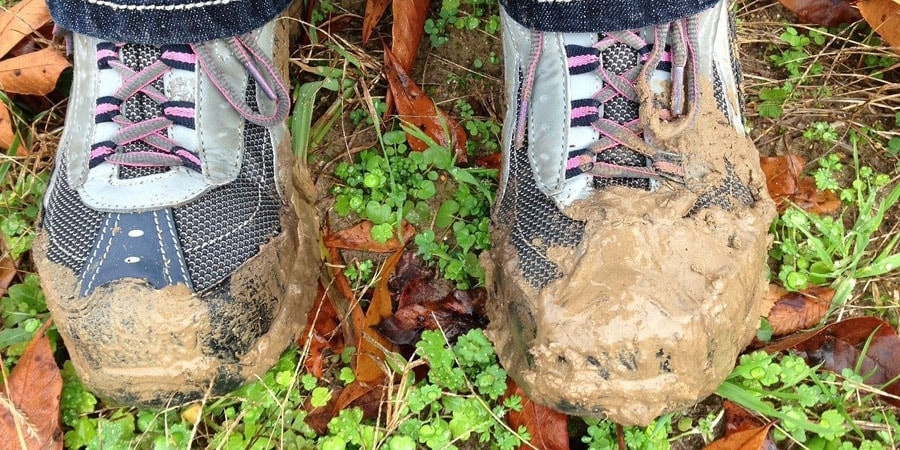 muddy wet leather boots