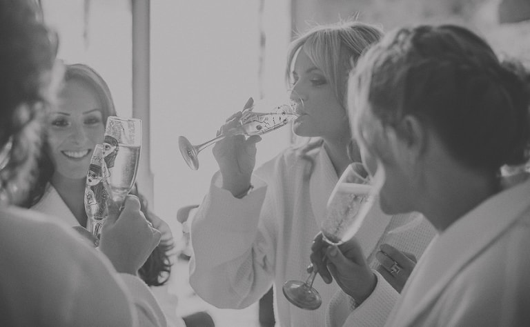 Bridesmaids drink champagne
