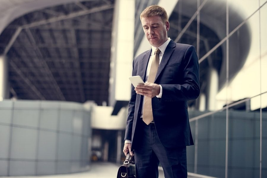 Businessman traveling with phone