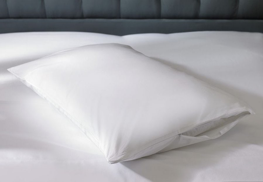 Using a pillow protector to extend the life of a pillow