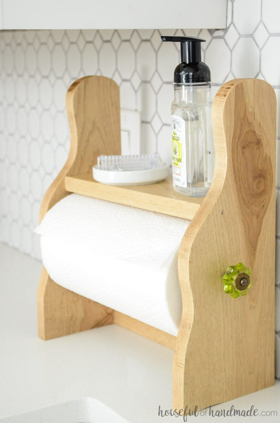 Farmhouse paper towel holder on kitchen counter with soap and brush
