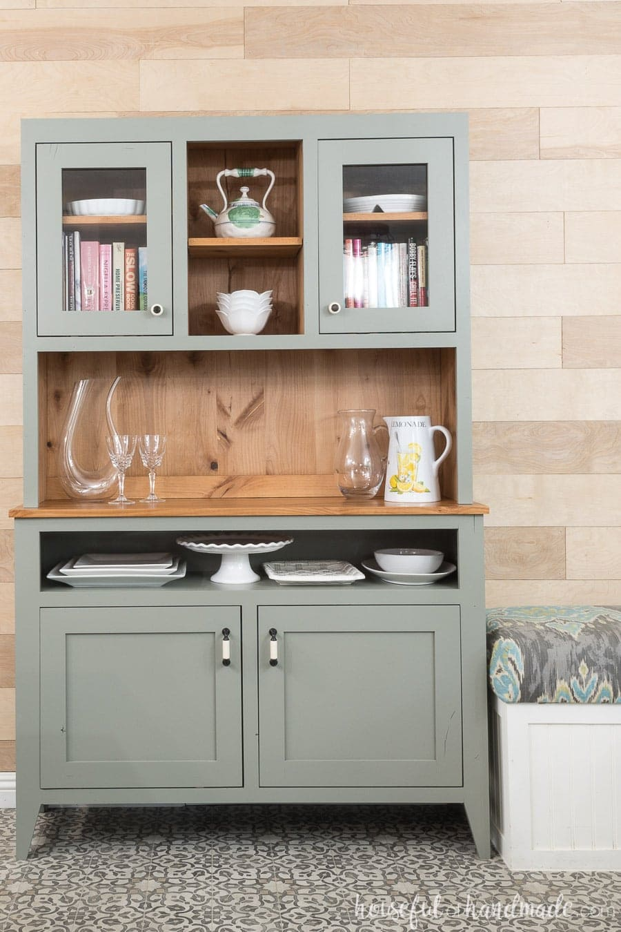 Gorgeous gray dining room hutch with natural knotty wood in the inside. Lots of storage and display space.