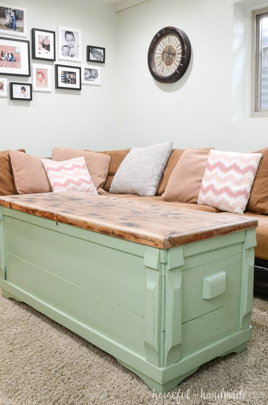 Moss green painted storage chest with raw cedar wood top as a coffee table in a living room.
