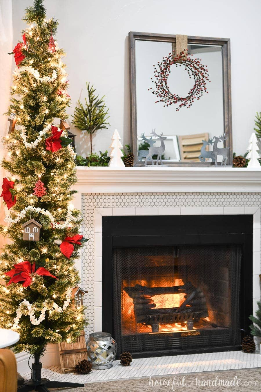 Pencil Christmas tree decorated with classic Christmas touches like popcorn garland and poinsettia flowers.