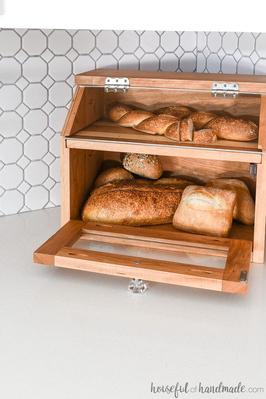 Lower door of the DIY bread box open to show how much room there is inside.
