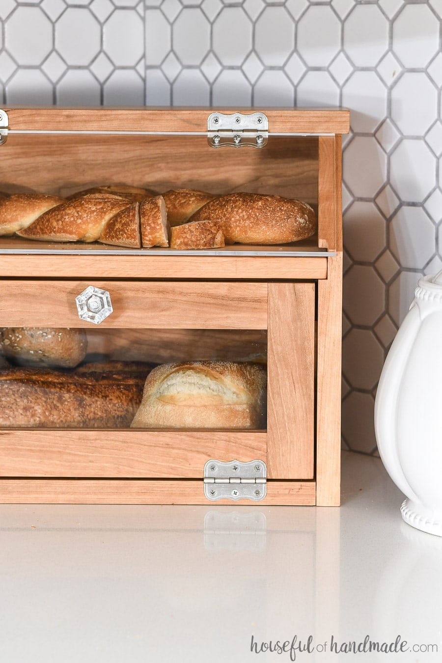 Close up view of the DIY bread box full of bread on the kitchen counter.
