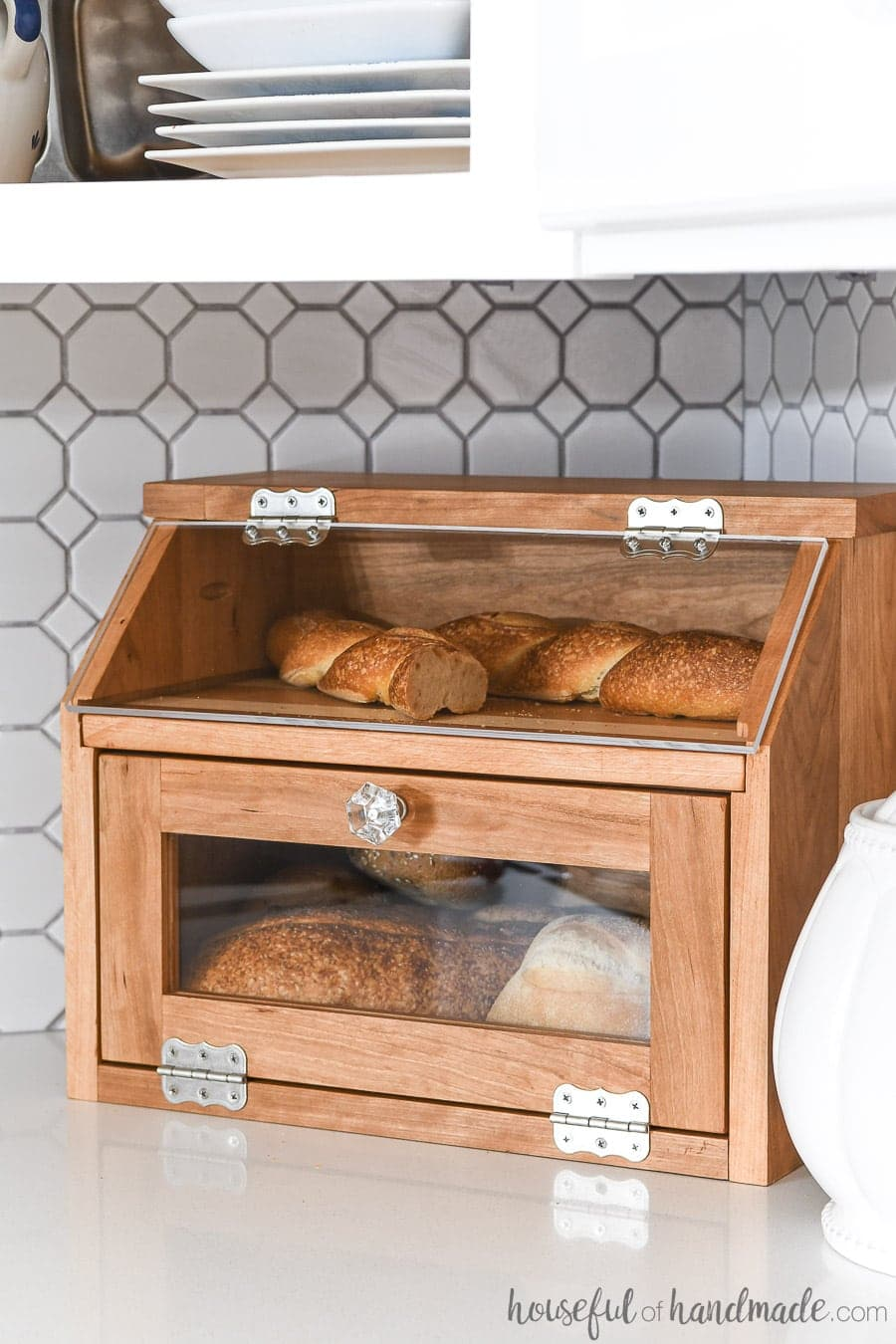 DIY bread box made of cherry wood with pull out cutting board shelf.