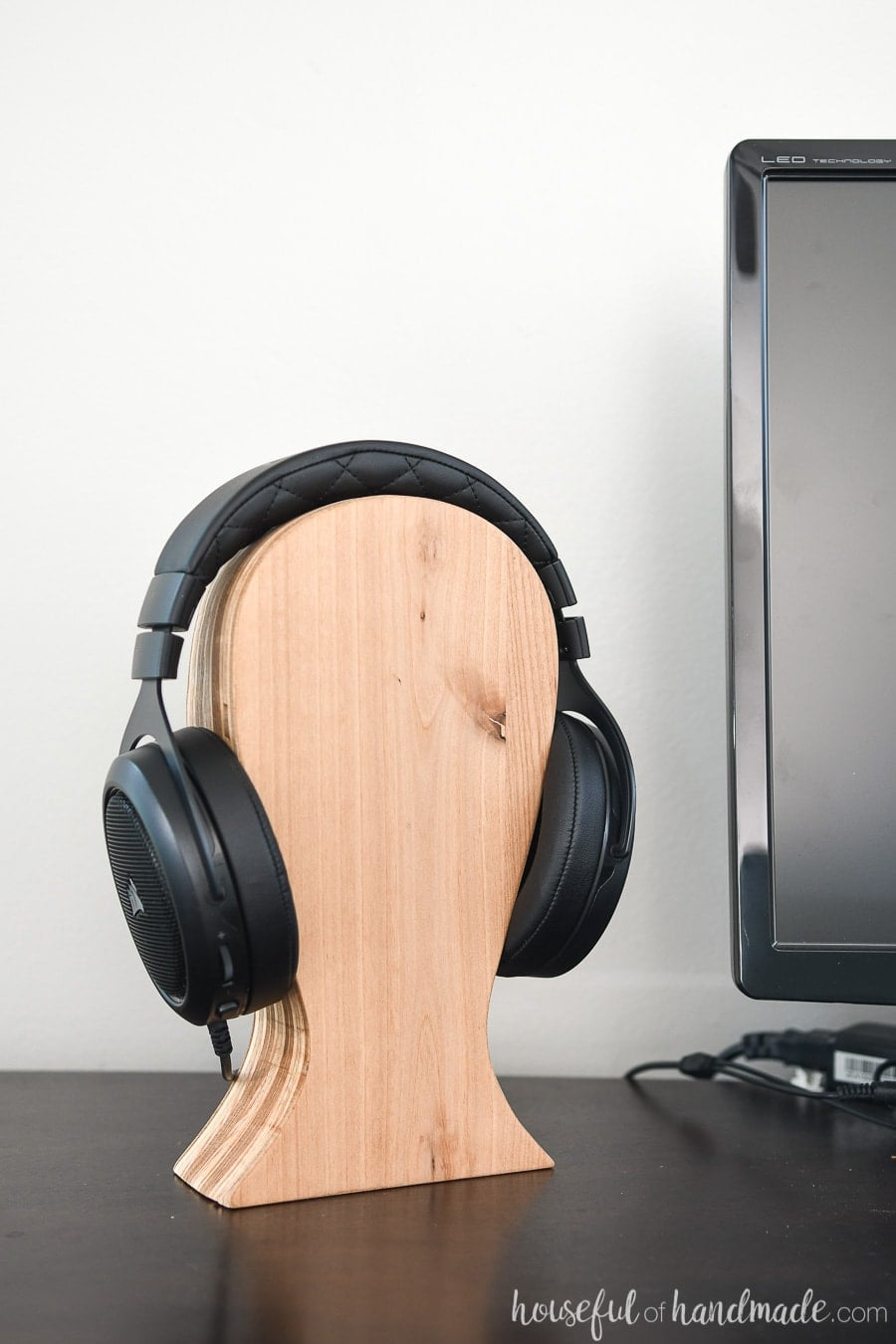 Computer desk with headphones on a DIY headphone stand.