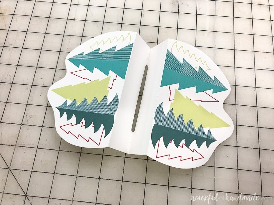 Cut out Christmas gift card holder with folds along all the dotted lines.