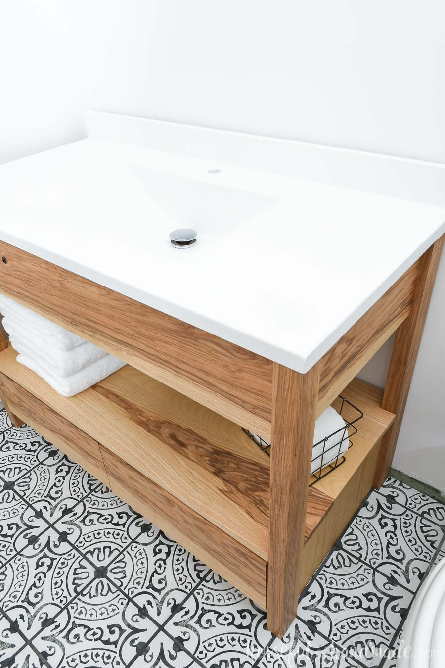 """White one-piece vanity top with sink on top of a 42"""" bathroom vanity built from these free plans."""