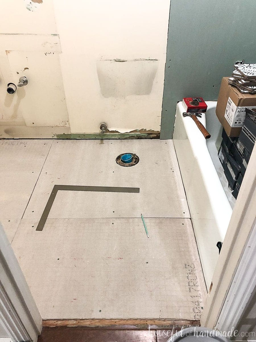 Blank floor of the bathroom before setting out floor tiles for the bathroom tile installation.