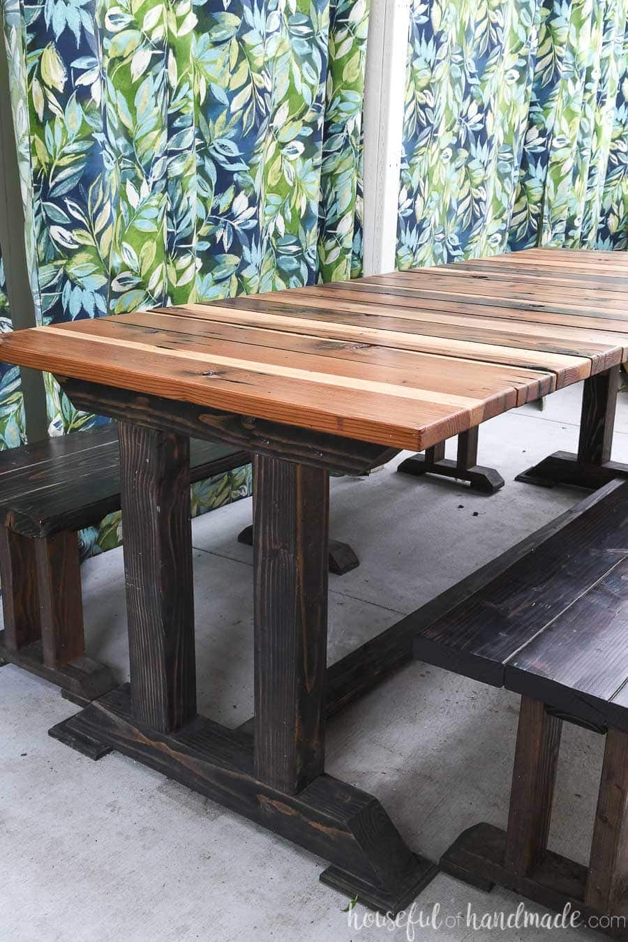 Beautiful wood table build from the picnic table plans on a patio.