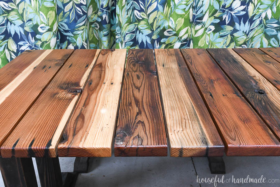 """Side view of the wood picnic table top with 1/4"""" gaps."""