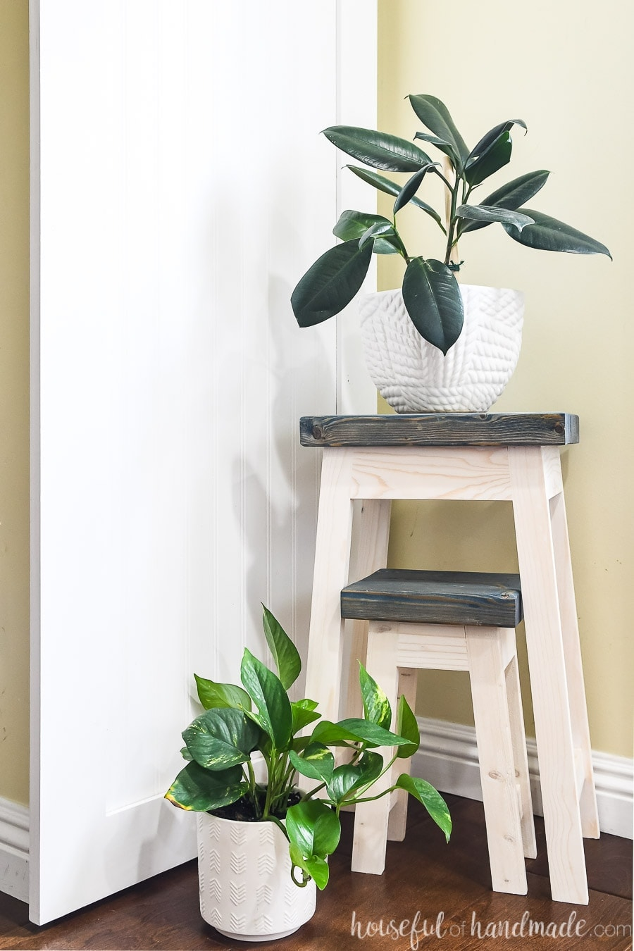 Nesting plant stands with the small stand tucked under the large one.