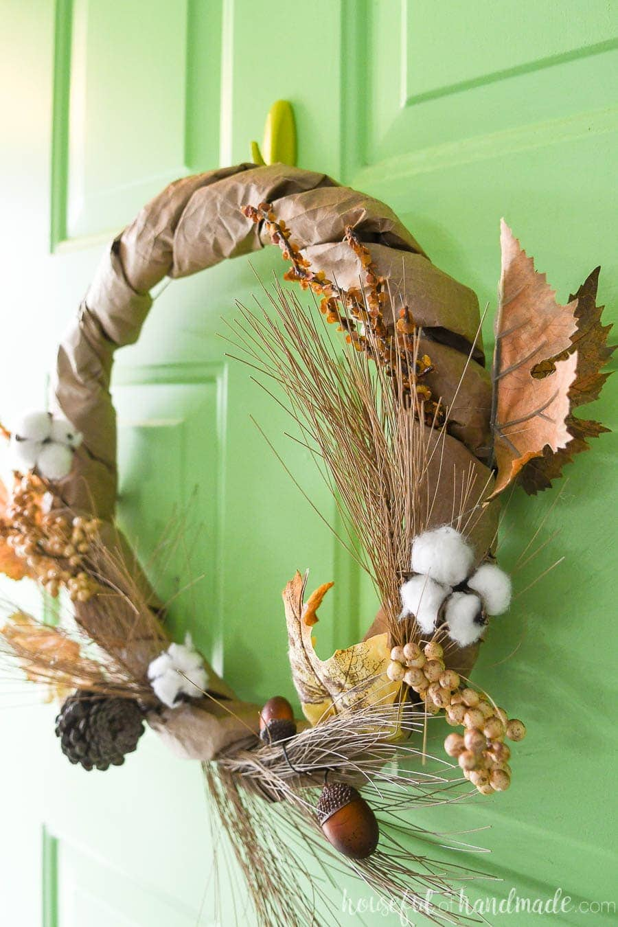 Sideways view of the neutral fall wreath made from upcycled paper grocery bags and faux floral.