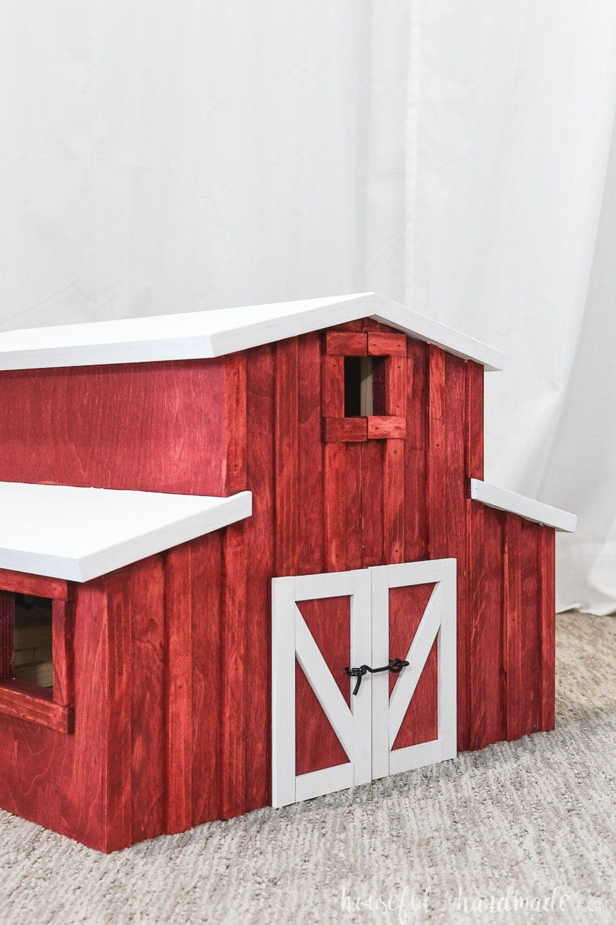 Red barn dollhouse all closed up and latched.