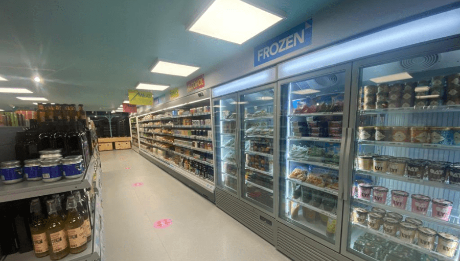 Hisbe ethical supermarket interior showing aisles and frozen goods in freezers- air conditioning solution by SubCoolFM & refrigeration by Capital Cooling