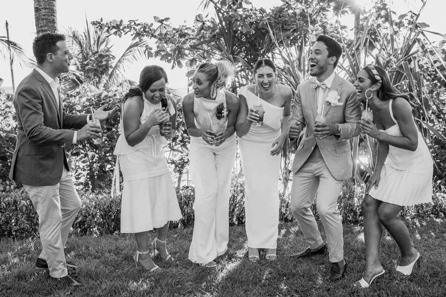 A wedding entourage share a laugh by Shangri-La wedding photographer Julian Abram Wainwright