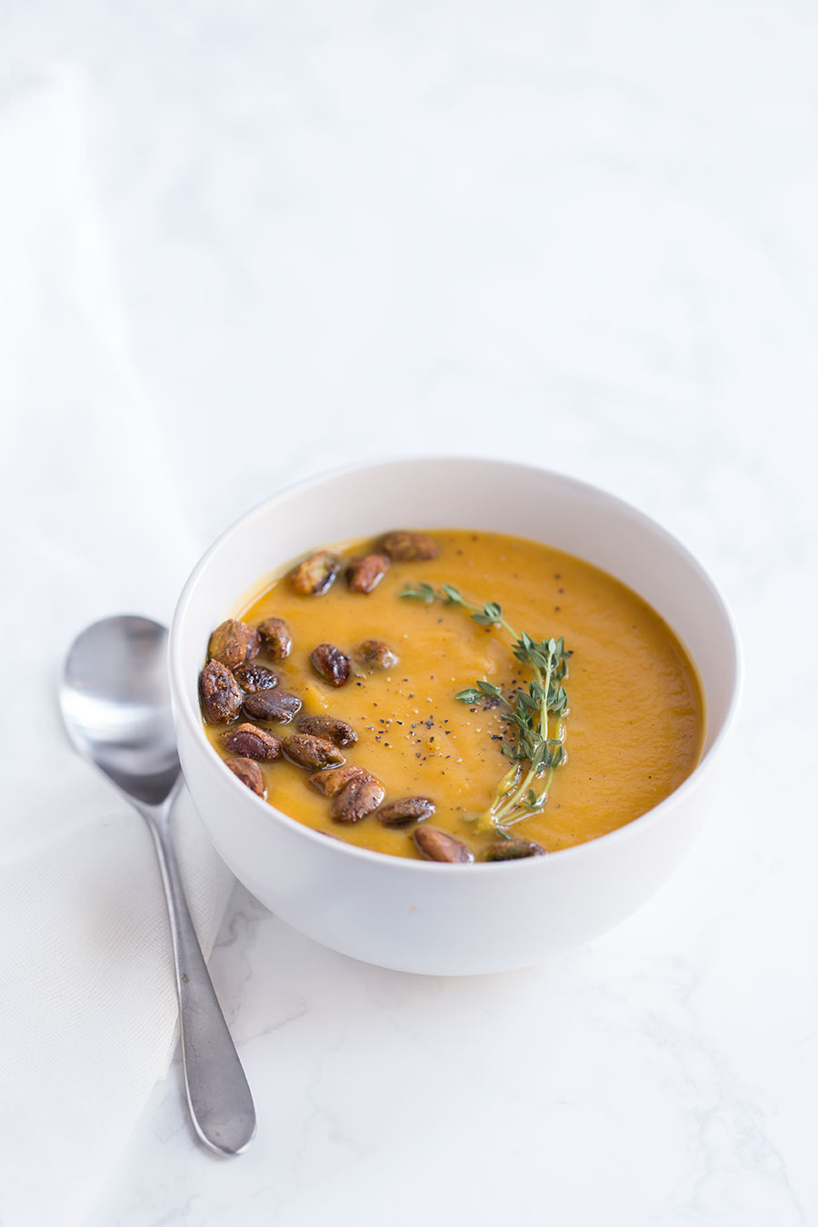 This rich, creamy Roasted Butternut Squash Soup takes things to the next level with a quick and easy Spiced Pistachio garnish! The nuts are totally optional, but they add tons of texture and flavor.