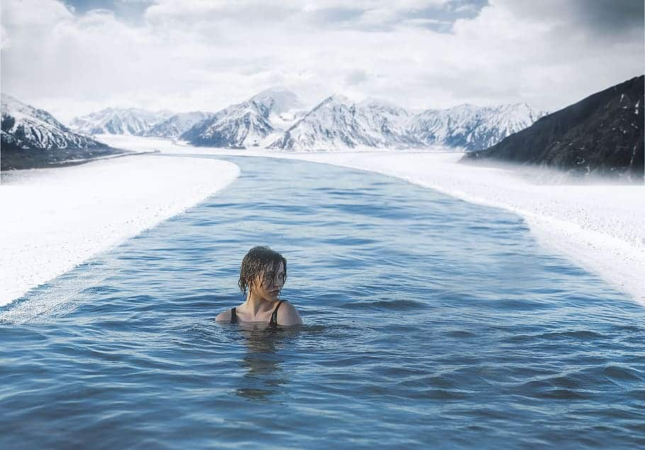 a girl bathing outside during winter