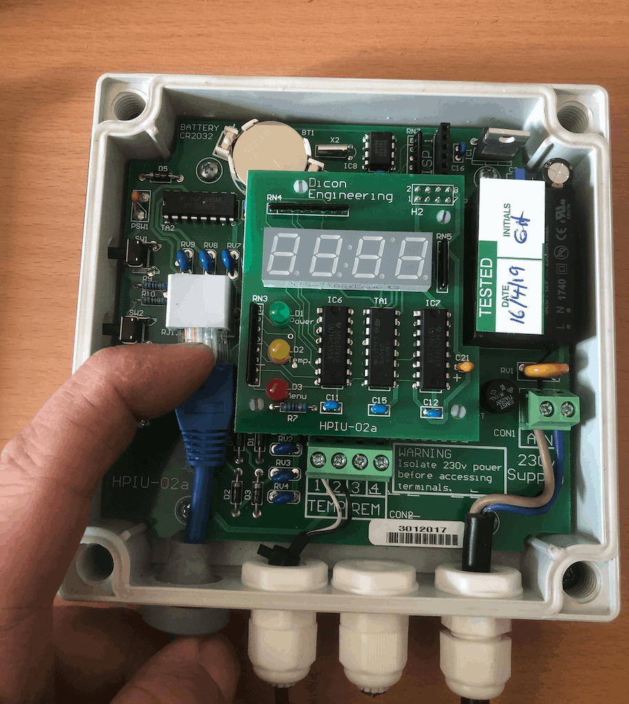 Disconnecting the patch cable inside the Reclaim Energy heat pump controller